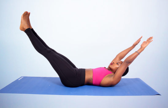 Fitness woman doing hollow body hold