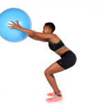 Fitness woman doing squats with swiss ball