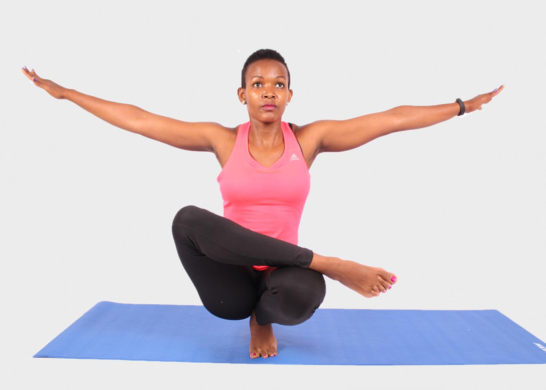 Fitness woman doing yoga balance exercise