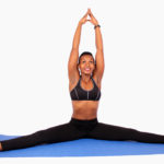 Fitness woman doing yoga leg split