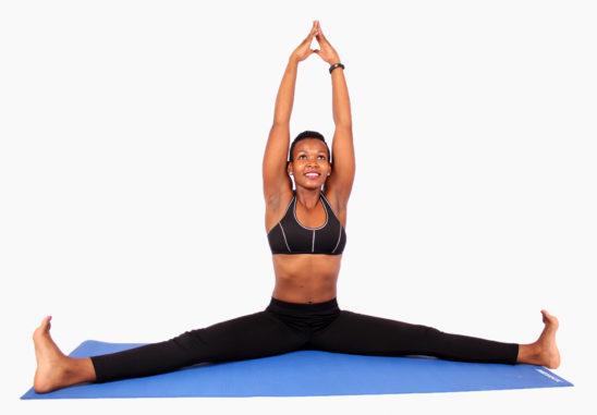 Fitness woman doing yoga leg split