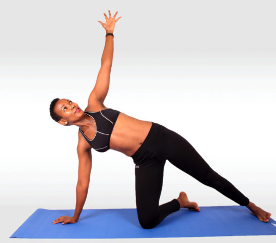 Fitness woman doing yoga pose looking up