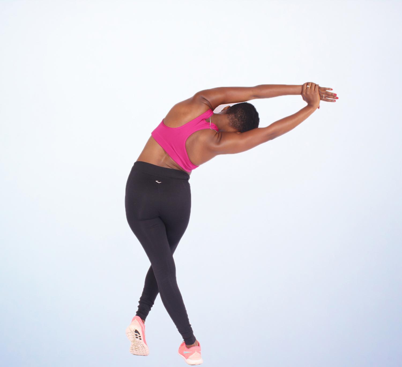 Fitness woman doing yoga pose side bend