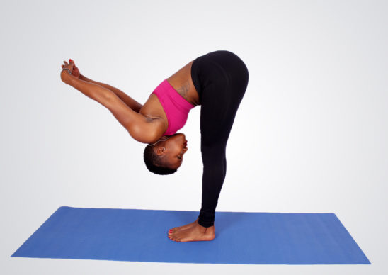 Fitness woman doing yoga stretch