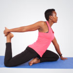 Fitness woman doing yoga stretching hip flexors