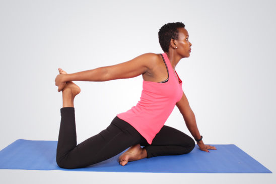 Fitness woman doing yoga stretching hip flexors