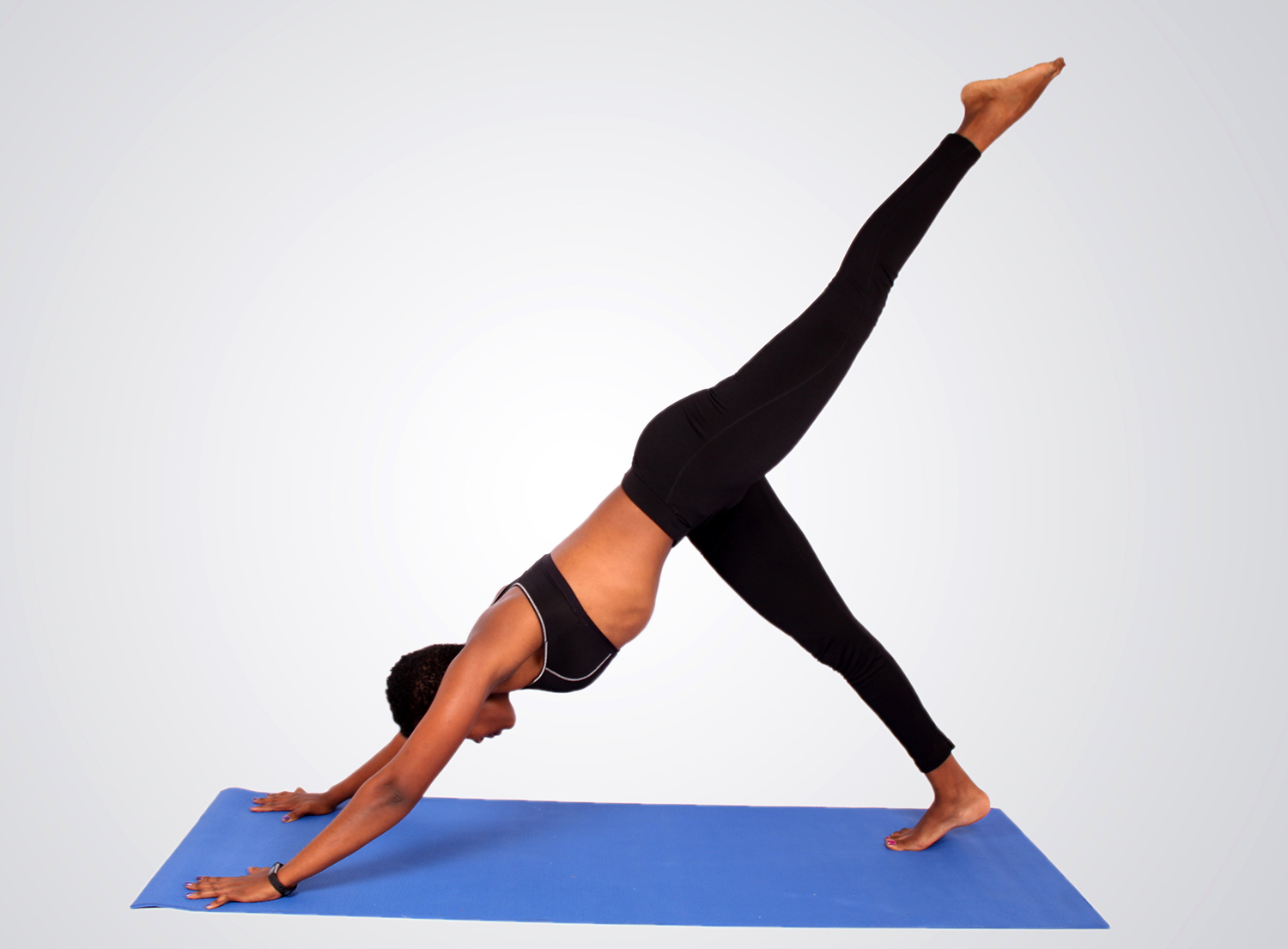 Fitness woman doing yoga with one leg raised