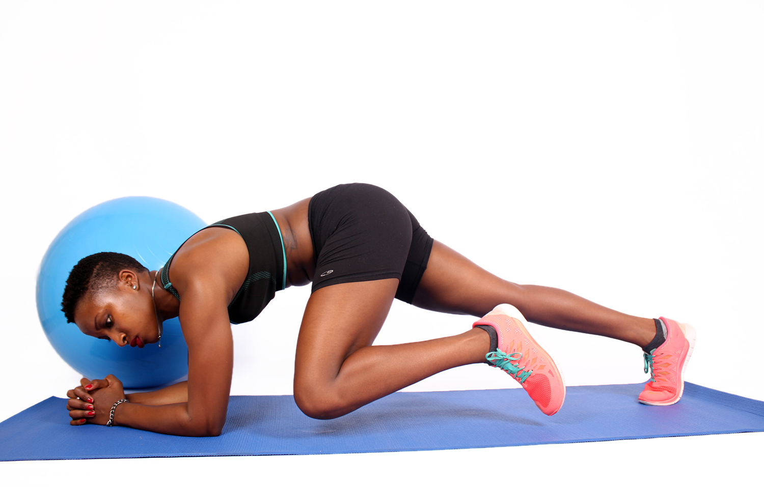 Fitness woman exercising next to swiss ball