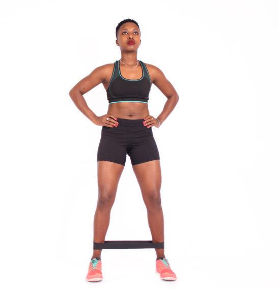 Fitness woman exercising with resistance band exercise