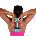 Fitness woman lifting bumbbell behind neck