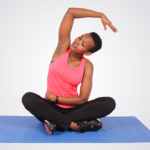 Fitness woman sitting on yoga mat