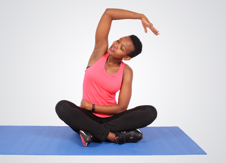 Fitness woman sitting on yoga mat