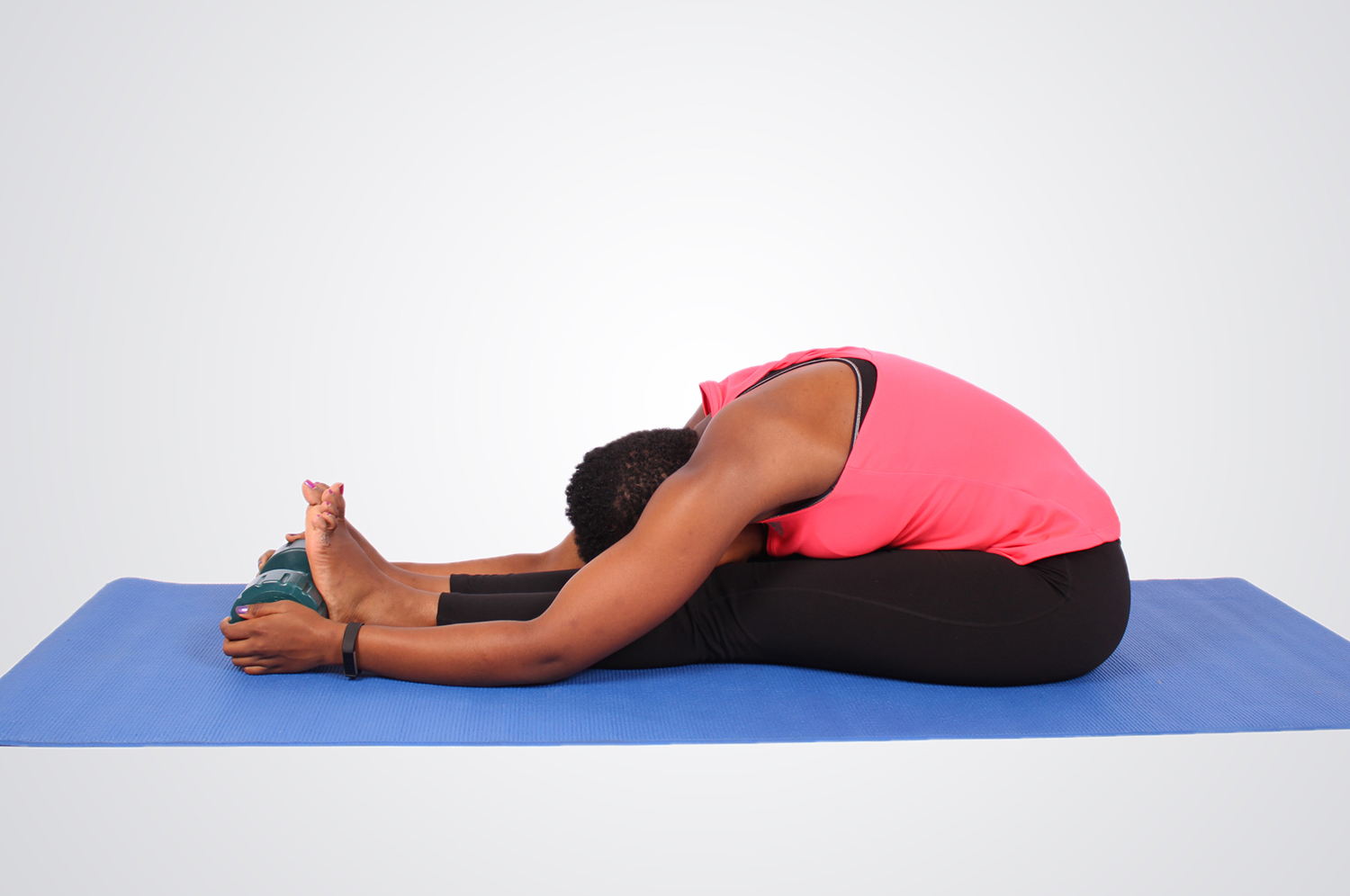 Fitness woman stretching legs and back holding bumbbells