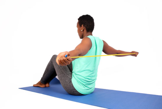 Fitness woman stretching shoulders with resistance bands
