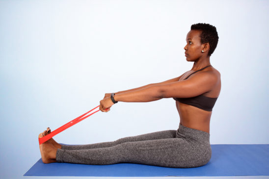 Fitness woman stretching with resistance bands