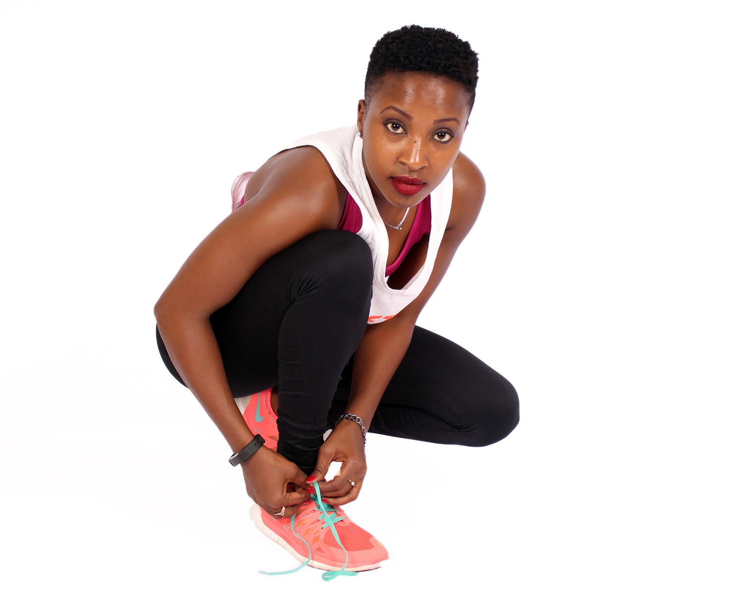 Fitness woman tying her shoes
