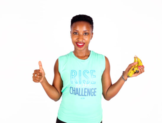 Fitness woman with bananas