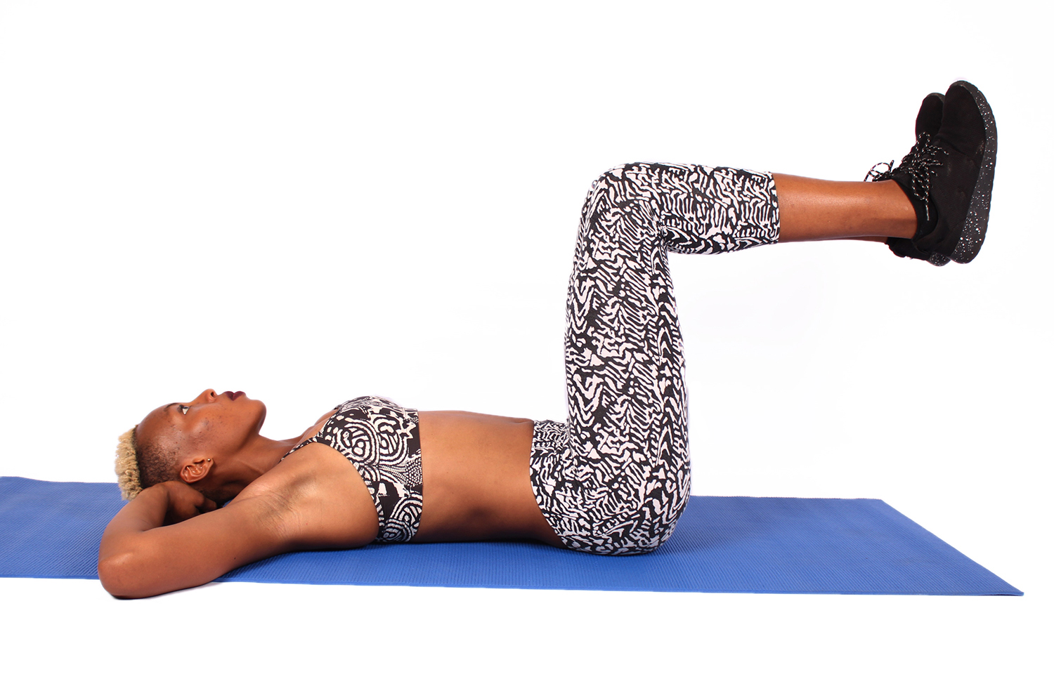 Fitness woman with bent raised legs