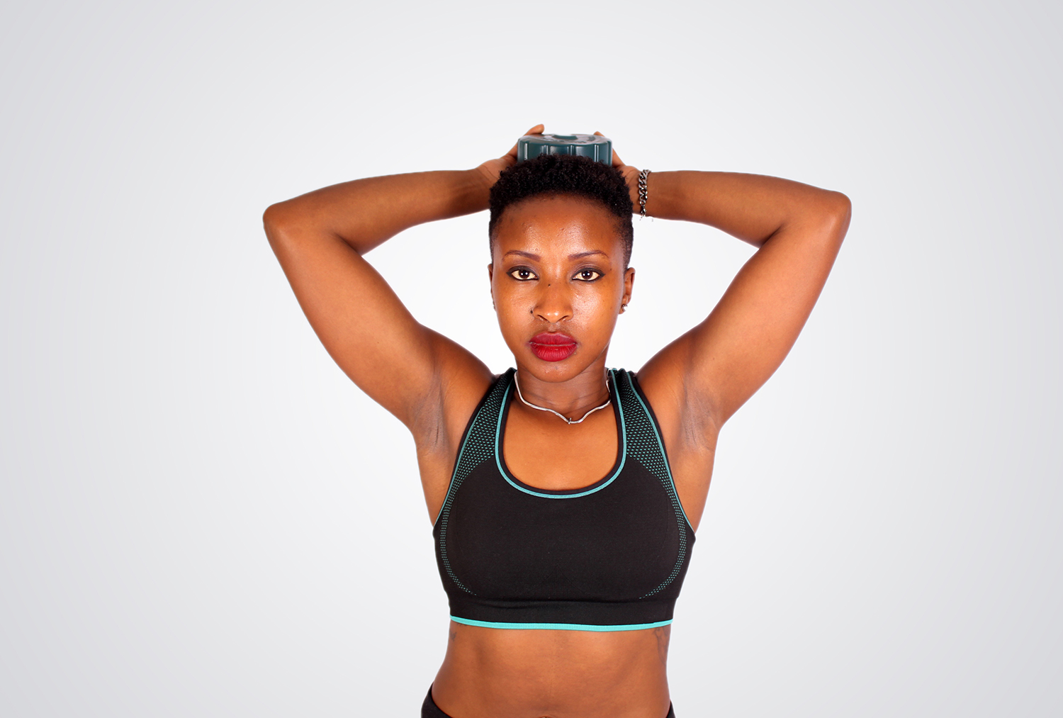 Fitness woman with dumbbell behind head