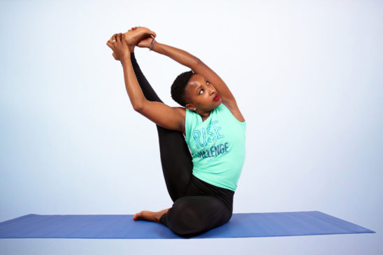 Flexible african woman doing yoga stretch