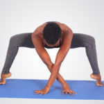 Flexible woman doing yoga pose