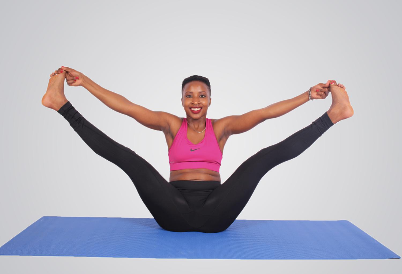 Flexible woman doing yoga pose smiling