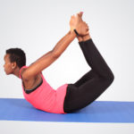 Flexible woman stretching back doing yoga