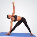 Focused woman doing yoga
