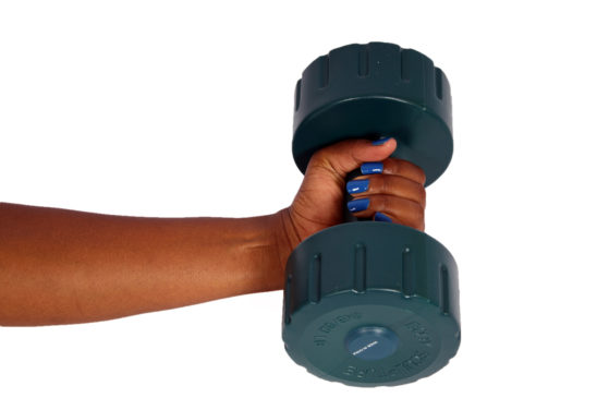 Hand of black woman lifting dumbbell