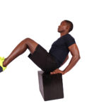 Man doing crunches and v ups on step up box