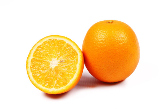 One orange and one orange slice on isolated white background