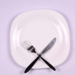 Plate knife and folk dieting concept