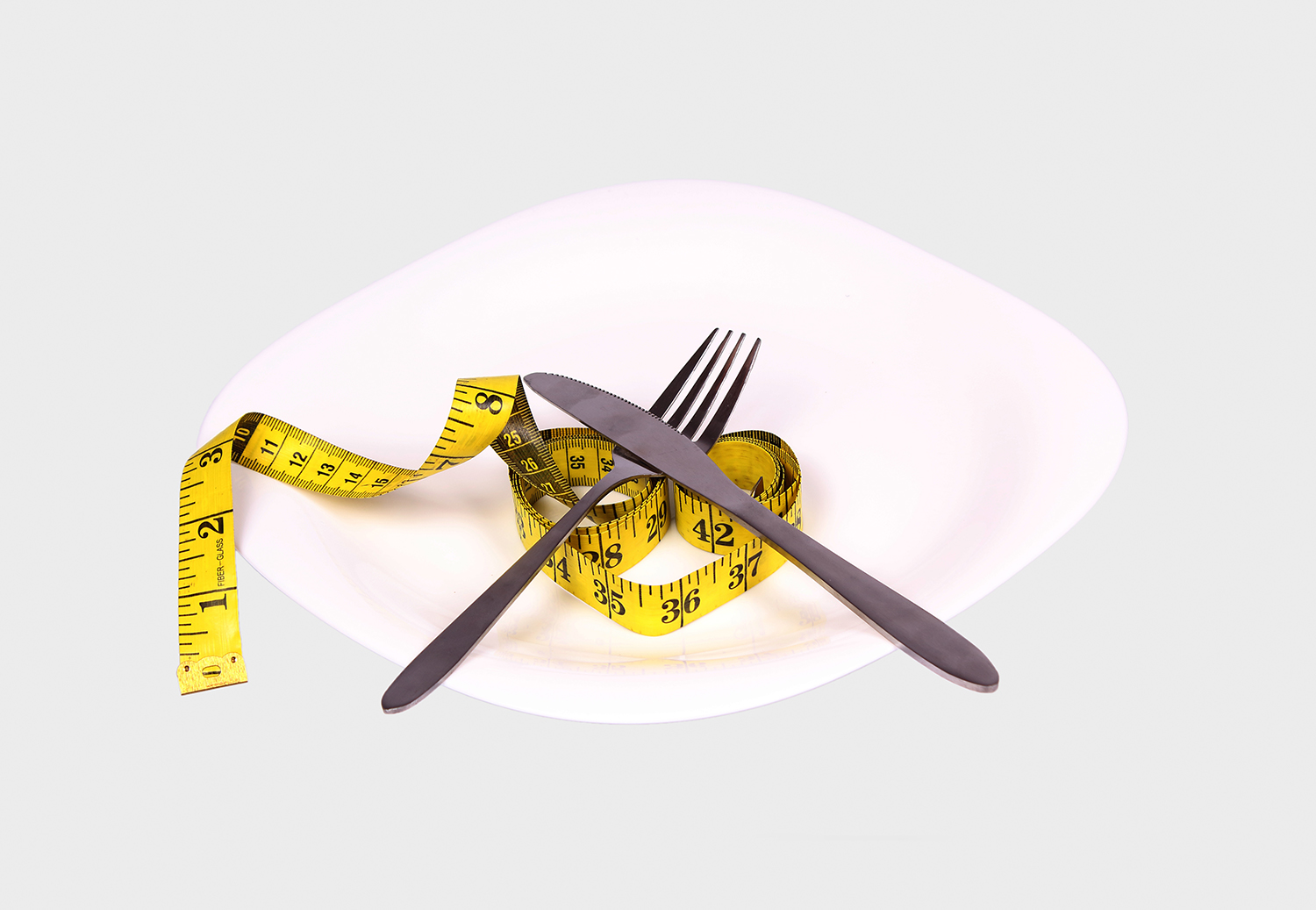 Plate spoon folk and tape measure dieting concept