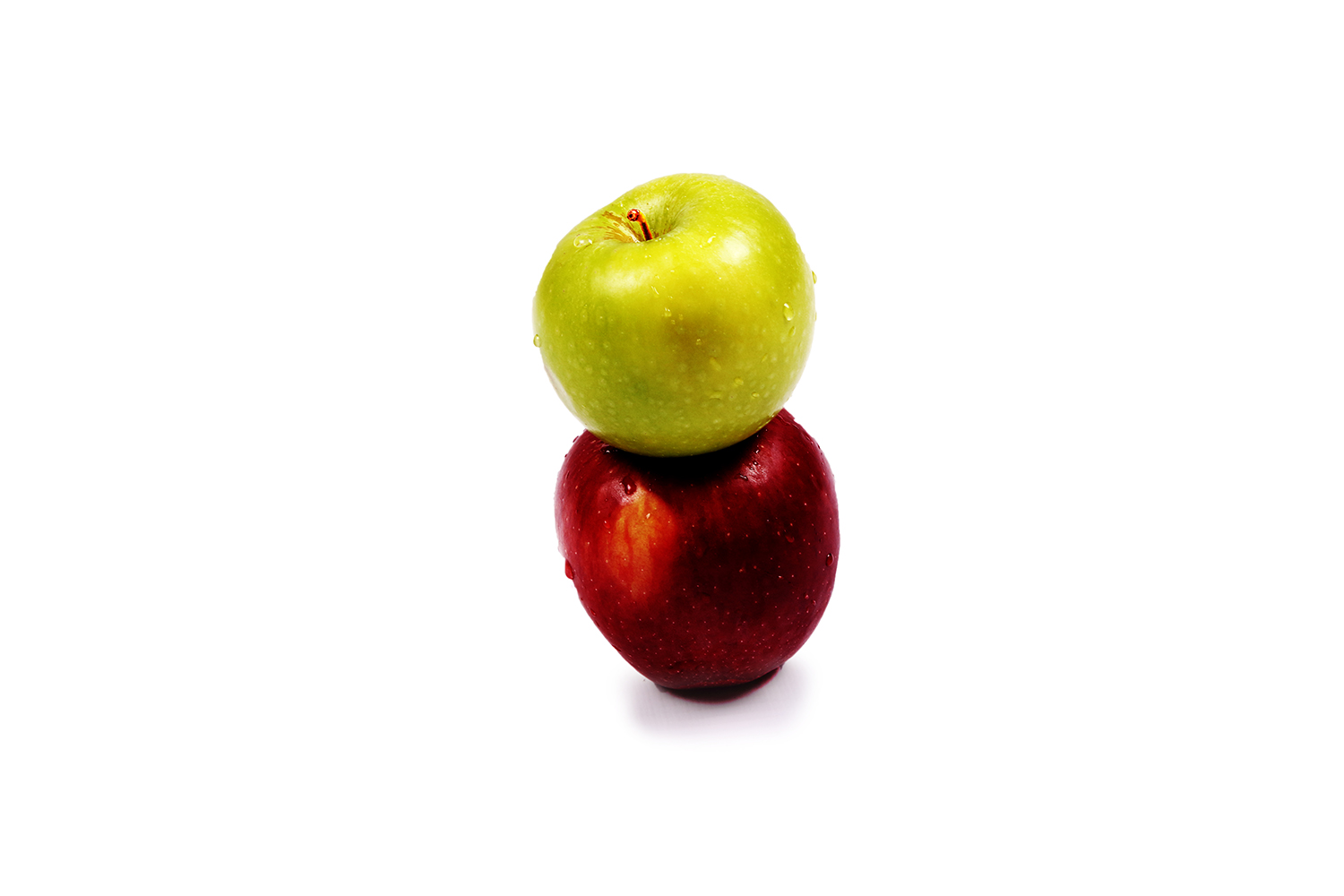 Red and green apple on isolated white background