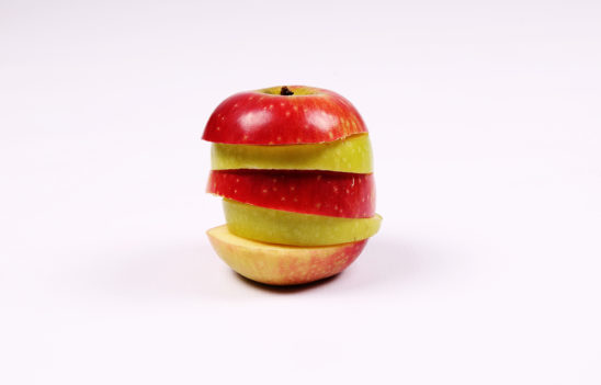 Slices of red apple and green apple