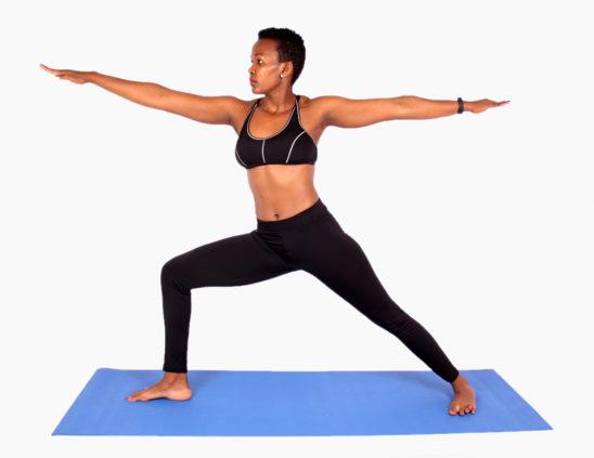 Slim yogi doing warrior pose
