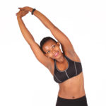 Smiling fitness woman stretching