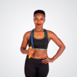 Smiling fitness woman with jump rope
