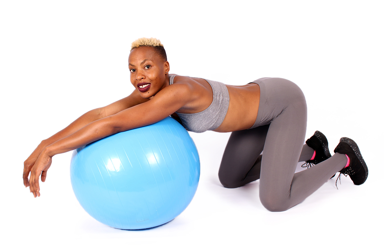 Smiling woman exercising on swiss ball