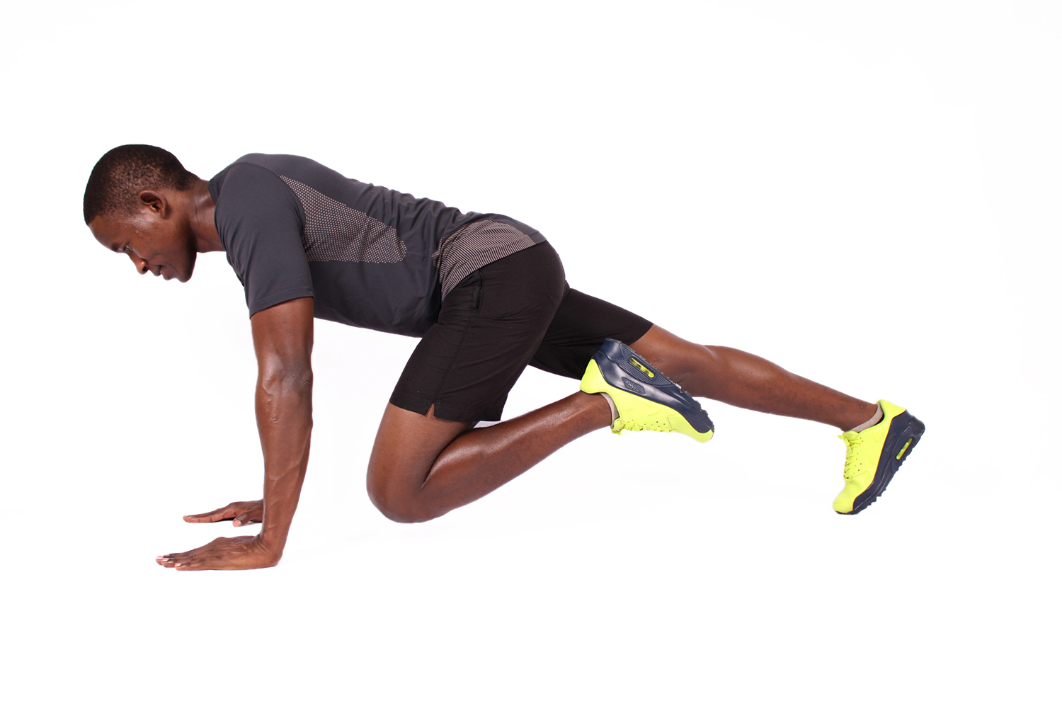 Sporty african man doing mountain climbers ab exercise