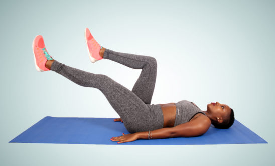 Sporty woman doing ab exercise on yoga mat