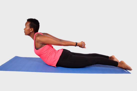 Sporty woman doing back yoga stretch