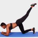 Sporty woman doing donkey kick exercise