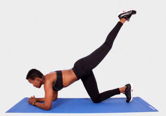 Sporty woman doing donkey kick exercise