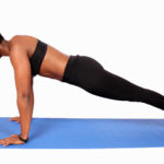 Sporty woman doing push ups and straight arm plank