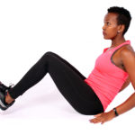 Sporty woman doing v ups crunch ab exercise