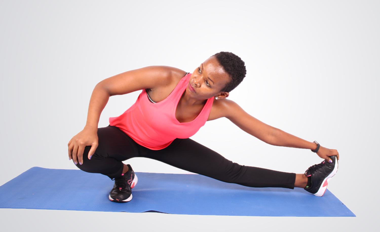 Sporty woman stretch legs