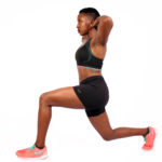 Strong fit woman doing lunges without weights