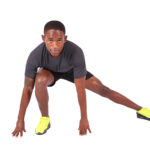 Strong fitness man stretching doing side lunges