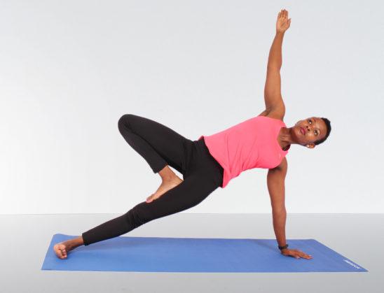 Strong fitness woman doing yoga